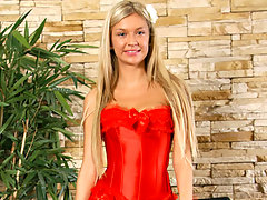Sweet blonde in hot red lingerie plays with a vibrator at Nubilesvideo