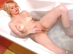 Cum starved blonde teases her pussy gently in the bathtubvideo