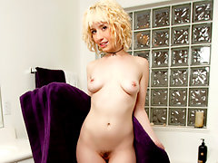 Desirable Nubile fucks her hairy pussy with a toy in the tubvideo