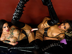 Bonnie Rotten\'s retiring from her kinky business and hanging over her studio to a new dominatrix. When Skin Diamond shows up to take over the reins, she gives Bonnie all kinds of disrespect. Mistress Rotten\'s got no choice but to drop this new girl to her knees and give her a lesson in manners. The two dommes whip out all their toys and techniques, stretching each other\'s holes and fucking to horny new heights of pleasure.video