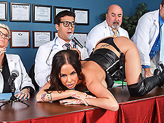 Dr. Aniston is seriously slutty. Not only does she dress like a whore, she admits to fucking her patients! When she faces the review board, they decide to revoke her license because of her skanky behavior. But when she\'s alone with Dr. Ramon, she decides to plead her case one last time...video