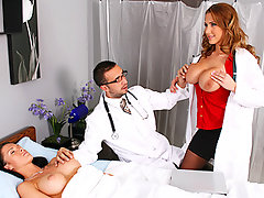 Alanah And Keiran are checking out their latest work, a breast implantation, on a patient.  Alanah doesn\\\'t think they\\\'ve made the breasts big enough, where-as Keiran thinks they\\\'re perfect. To prove how much better they could be, she pulls out her bigger boobs and convinces him otherwise.video
