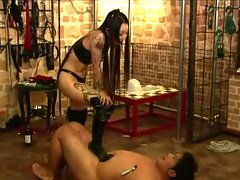 Payback time  this female dominatrix tortures hes slave as men does in bondage movies. The tables had turned and this femdom will give no mercy to these bad boy slaves. These male slaves are burn with candle wax  whipped  spanked and gagged. See how femdoms punish their slaves in comparison to bondage girls.video