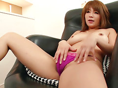 Rika Aina in fishnet nylons plays with her furry snatchvideo
