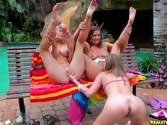 Dont miss these hot babes eating each other out pool side.video