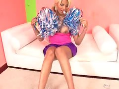 Spicy blonde cheerleader brushes her pom poms all over her sexy shemale body. Her cute breasts hang loose and she wiggles them towards the camera while shaking those pom pomsvideo