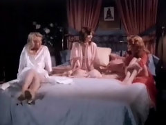 Three girls in night gowns are sitting on a bed, talking to each other. Two of them begin to make love with one another while the third one watches them. Finally she takes her clothes off and joins in, having her tits and her pussy licked.video