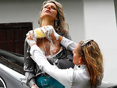 Nevermind that these two babes aren\'t at all dressed for the occasion, clearly they had a mind to get nice and wet from the very get-go as it doesn\'t take long at all for them to start sponging each other down!video