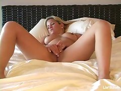 Lia 19 plays on her bedvideo