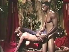 A black girl is fondling her naked breast while a black guy is watching her. She gets down on her knees to suck his dick. Then she goes on all fors so the guy can fuck her from behind until he comes all over her big tits.video