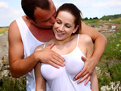 A young couple is playing hide and seek on de side of a hill. After a while the guy stands behind the girl and plays with her tits. When they are both naked he licks her pussy. Then he fucks her from behind and comes over her tits.video
