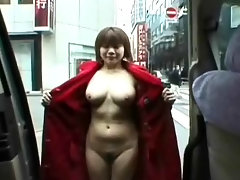 A Japanese girl is in a park. When she opens her long coat, she is naked underneath. She walks through the park, showing her body off to the camera. Then she takes a taxi to the city center where she shows herself off too.video