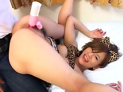A half naked Asian girl is squatting on a bed, moving her pussy over a vibrator that a guy is holding for her. A little later she lays down on her back and lifts her knees over her shoulders so the guy can fuck her again with the vibrator.video