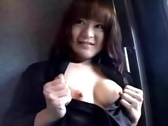 A young Asian girl is on a train, flashing her tits at the camera. She lifts up her skirt, showing her hairy pussy. A little later she does the same again in the back of a car.video