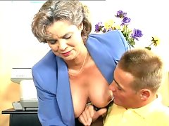 Kelly is training a young hunk in her office. But it seems like this hunk is more interested in her tits and starts squeezing and pinching her already erect nips. She doesn't mind as long as she gets to perform some oral examination and have him drill her hard.video