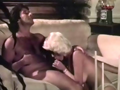 A blonde woman leads a man into her newly renovated living room. She undresses slowly and then goes down on her knees to suck his dick. The both of them end up fucking on the floor until the guy comes in her mouth.video