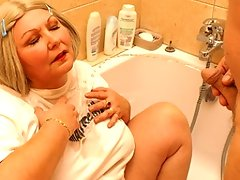 This chunky mama loves a golden shower in her bedroomvideo