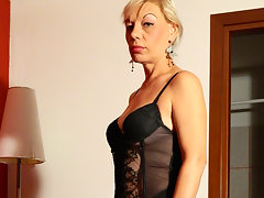 Blonde housewife playing with two toysvideo