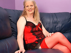 Horny mature slut masturbaying on the couchvideo