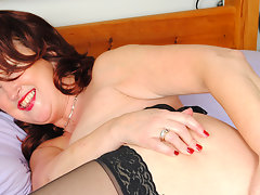 Naughty red mature slut playing with herselfvideo