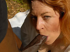 This red mama loves to swallow black cockvideo