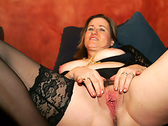 Kinky housewife playing with a huge dildovideo