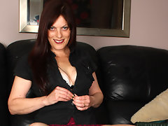 Horny housewife playing with her pussy on the couchvideo