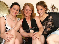 Three old and young lesbians go at it on the couchvideo