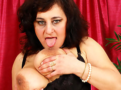 Horny big titted mature slut playing with herselfvideo