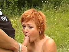 This red mature nympho loves fucking in an open fieldvideo