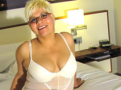 Blonde mature slut playing with her big dildovideo