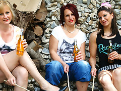 Three old and young lesbians make out in the gardenvideo