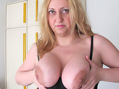 Chubby big breasted mama playing with a toyvideo