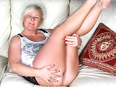 Horny blonde housewife playing on the couchvideo