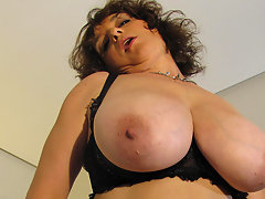 Big titted mama playing with her toysvideo
