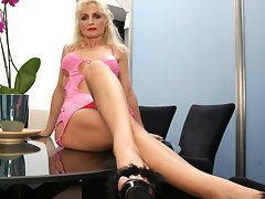 Horny MILF masturbating on her glass tablevideo