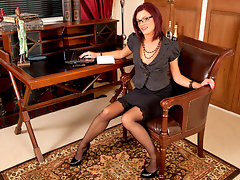 Hot secretary wearing glasses plays with her fuzzy pussyvideo