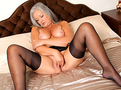 Elegant granny shows off her soft full curves and big boobs in sexy lingerie then sheds it all to pummel her juicy hole with a rabbit toyvideo