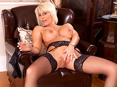 Classy blonde cougar Jan Burton massages her tits and her clitvideo