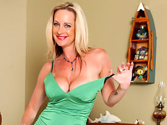 Busty blonde milf fucks her shaved pussy with a toy by the pianovideo