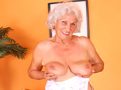 Big titted grandma plays with her boobs and her old pussyvideo