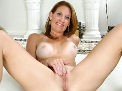 Busty milf with tan lines masturbates on her floorvideo