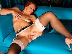 Classy cougar slides her panties over her heels to pleasure her pussyvideo