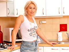 Anilos Samantha White fingers her shaved pussy on the kitchen countervideo