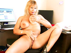 Horny executive takes a break to play with her huge tits and pussyvideo