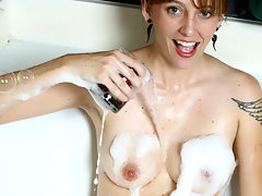 Adorable red haired housewife gets naughty in the bubble bathvideo