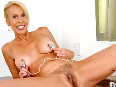 Busty Anilos cougar uses a vibrating egg on her nipples and pussyvideo