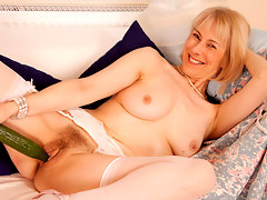 Elegant granny fucks her mature pussy with a thick cucumbervideo
