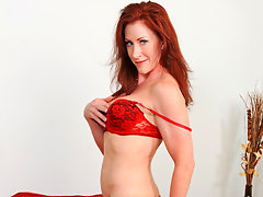 Foxy red head Catherine Desade fingers her shaved cougar pussyvideo