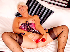 Short blonde haired cougar Sally Taylor is a thick milf with a sensual side that must be seen. Let her lure you into her sexual world by watching her stimulate her honey dripping pussy with a variety of toys!video